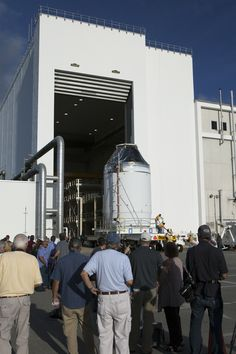 The Orion crew module, stacked atop its service module, moved out of the Neil Armstrong Operations and Checkout Building at NASA's Kennedy Space Center in Florida on Sept 11. Orion was transported to the Payload Hazardous Servicing Facility at Kennedy where it will be fueled ahead of its December flight test. During the flight, Orion will travel 3,600 miles into space to test the spacecraft systems before humans begin traveling in Orion on future missions.