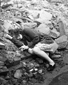 1945 young German girl cries 9n the ruins of a bombed out building after losing her entire family