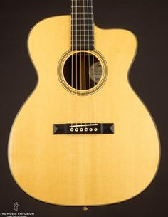 This Martin 00-30 from 1903 has a quality of tone that is purely sublime, combining the best aspects of steel and gut into one magical instrument. Martin Acoustic Guitar, Small Bridge, Music Instruments, Singer, Steel, Musical Instruments, Singers, Steel Grades, Iron