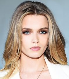 Abbey Lee Kershaw's brown smoky eye and center-parted hair draw you in to her soft, blue eyes