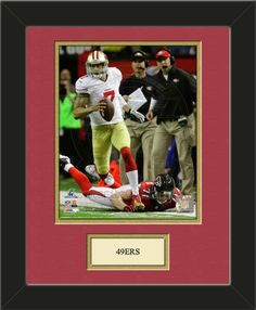 One framed 8 x 10 inch San Francisco 49ers photo of Colin Kaepernick with a customizable nameplate*, double matted in team colors to 11 x 14 inches. $49.99 @ ArtandMore.com