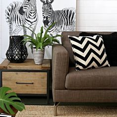 @villastyling has done it again! Creating this warm moody earthy look using our 'Indiana' side table 'Aurora sofa & home-wares from our Serengeti range! #style #homedecor #zebra #loungeroom
