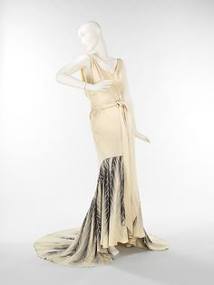 american silk evening gown. love the knotted tie at the waist, the feather pattern, the train (1932)
