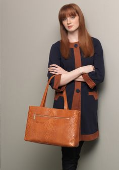 Melissa carrying the Morena in Amber Exotic. Perfect tote to carry from work to play #behobo #betechchic #fallfashion