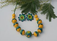Polymer clay beaded necklace, unique polymer clay, daisy fimo art clay . Beautiful handmade polymer clay Pendant in Flower style, Art Jewelry. My handmade and fantasy. Each flower leaf applied by hand. The unique flower. Colour and beauty are unique. In this combination of colours is also a ring. https://www.etsy.com/listing/491358448/statement-clay-ring-polymer-clay-jewelry?ref=shop_home_active_1  Suspension is covered with gold leaf and floral elements made of ...