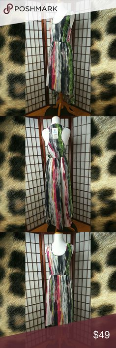 """Love Fire Sleeveless Assymetrical Blouson Dress New with tags Love Fire Size XL Assymetrical Dress Blouson Dress Sleeveless  Multi-color  Elastic waist Made of 100% polyester   Measurements approximate  Pit to pit 18.5"""" Shoulder to hem 57"""" Waist 32-36"""" Love Fire Dresses Asymmetrical"""