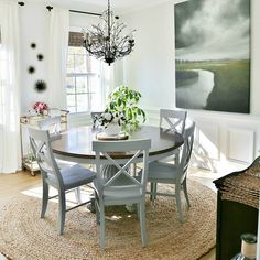Come tour this coastal dining room makeover reveal and see the before and after pics. It is lighter and brighter with a soft gray coastal color palette.