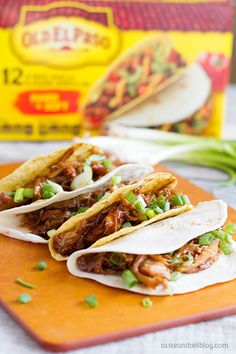 Chicken thighs are slow cooked in a honey, soy and garlic mixture, then shredded for the best Honey Garlic Chicken Tacos.