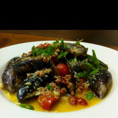 British Columbia Honey Mussels in a White Wine Butter with Roasted Cherry Tomatoes, Crispy Andouille Sausage and Parmesan