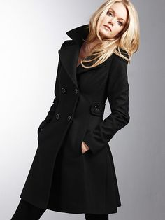 Side tabs and a wide lapel add sophistication to the tailored silhouette of this polished double-breasted coat