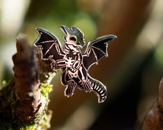 Skeletal Dragon Hard Enamel Pin by FrogDrops on Etsy Jacket Pins, Hard Enamel Pin, Cool Pins, Metal Pins, Pin And Patches, Pin Badges, Lapel Pins, Pin Collection, Brooch Pin