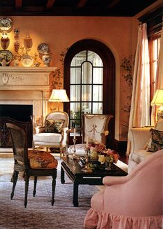 Beautiful arched window, carved mantel, gorgeous rug, apricot walls (The Enchanted Home: Designer spotlight: Cathy Kincaid)