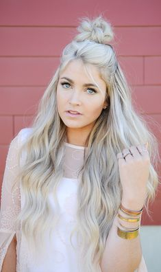 Cara Loren. Half up top knot with waves