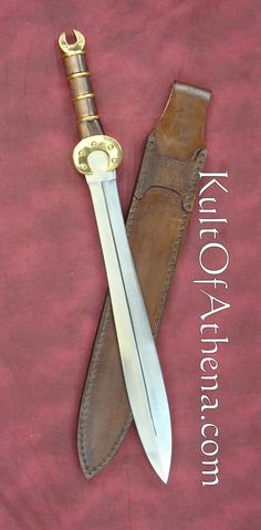 Kult Of Athena - Swords - - Celtic Short Sword - Features a double edged mirror polished stainless steel blade, with brown hardwood handle adorned with brass plated spacers and crescent hilt and pommel. Celtic Sword, Cool Swords, Celtic Warriors, Templer, Bravest Warriors, Sword Design, Medieval Weapons, Military Guns, Cold Steel
