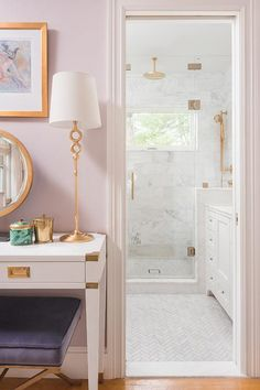 Lilac walls with campaign desk and gold accents