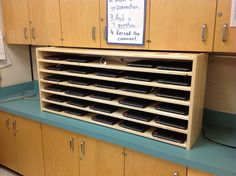 Our iPad Shelf by Kathy Cassidy, via Flickr This is the Front of a custom built iPad storage cabinet. This 1st Grade teacher's blog is pretty awesome because of the great strategies for creating organization systems for ipads.