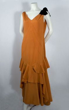 Silk crepe de chine evening dress, 1930's.  Being tall, I will never have a chance to buy vintage clothing. That being said this could look amazing on.