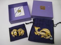 "A beatiful Brooch and Ear Clip Set, in Elizabeth Taylor's ""Sea Shimmer Collection"" by Avon featuring gold colored Koi fish, decorated with faux pearls, rhinestones, and a brilliant faux sapphire. Excellent condition, in original felt pouches and original box, with descriptive leaflet. Looks to have never been used. Size of brooch is 3 3/4"" x 2"", and ear clips are 1 1/2"" x 1 1/2"". A nice addition to your collection, or wardrobe. 