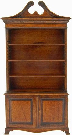 Alan Barnes, Tarbena - bookcase/open display cabinet with swan neck pediment and cupboards. Adjustable shelves.