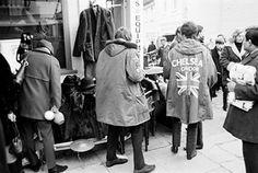 A group of mods shopping for parkas at Portobello market in 1964