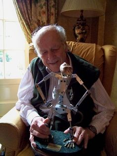 "Ray Harryhausen, legendary stop-motion animator tinkering around with a metal skeleton armature of "" MIGHTY JOE YOUNG "" if I was to guess..."