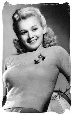 1940s fashion. Sweater girl and movie star, Carol Landis... the late1940's introduce the torpedo (or bullet) bra, becoming an iconic look of the 1950s. Sweater Girls and Bullet Bras #bulletbra #secretsinlace