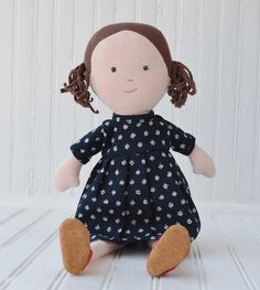 Louise, a human girl, loves to explore the forest by herself. She is made of organic cotton jersey and measures 14 inches tall. Louise comes wearing a Liberty of London floral dress, red bonnet, and r
