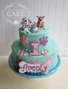 A puppy cake for a 1st birthday. Buttercream iced. Paw...