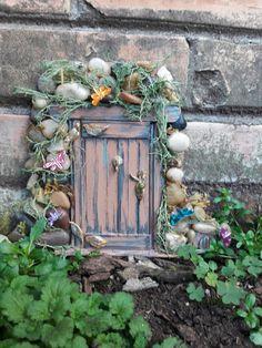 Fairy door with dragon fly annex.