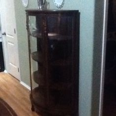 And this is what I bought!!! It's not like what I pinned. An antique :). I've already oiled the wood, changed out the dowels holding the shelves, and added a light.