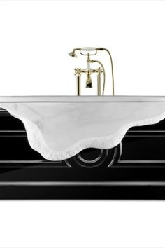 This bathtub combines Ibiza marble and wood and is inspired by the ancient city of Petra, where buildings are directly carved in stone cliffs. The black gloss looks of the wood matching the different shades of white turn this piece into one everlasting exclusive visual experience for the most luxurious bathrooms.