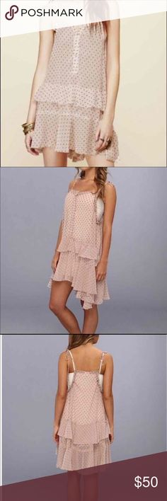 Free People Slip Dress/Tunic. SALE TODAY ONLY! Size S, Rayon Buttons down front Ties on shoulders Can gather the bottom for a more flowy look on the sides The color is Pink and light tan dots Excellent Used Condition. REASONABLE OFFERS ACCEPTED!! Free People Dresses Midi