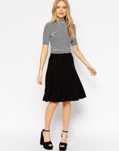 $36, Black Skater Skirt: Asos Collection Midi Skater Skirt. Sold by Asos. Click for more info: https://lookastic.com/women/shop_items/293117/redirect