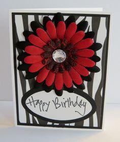 Handmade birthday card.  Red and black flowers on zebra.
