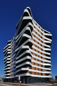 The irregularly shaped balconies project from each corner of the 13-storey-high tower, which was recently completed by Rotterdam studio 24H architecture. Netherlands