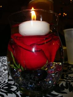 red rose centerpieces & candles :  wedding red roses hypericum floating candle