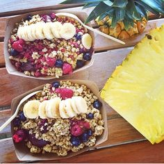 An açai bowl is a thick smoothie of açai fruit blended with a liquid, banana, and other berries, topped with granola, fresh fruit, shredded coconut and a liquid sweetener.