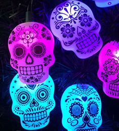 NEW Sugar Skull LED Light String I love these! Very cool to hang on your ofrenda, around a window or your front door. Watch them change color between purple, blue, magenta and turquoise. There are 10 sugar skull lights that extend to 11 feet long. I'm going to use mine on my Christmas tree too! A5143 $26 each