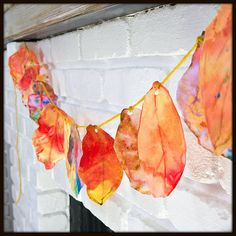 This adorable garland of autumn leaves craft is a way to use up coffee filters, spruce up the house, and practice fine motor skills all at the same time. It's a perfect craft for toddlers and preschoolers, and the whole family can enjoy it when