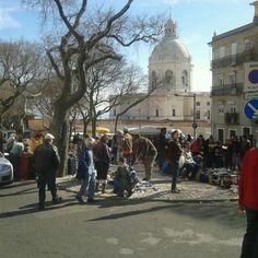 Photo taken at Feira da Ladra by Andre F. on 2/21/2012