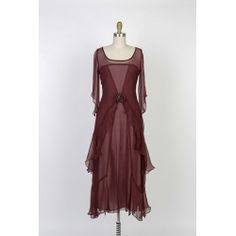 Natay Garnet Vintage Inspired Dress.Stunning new colors available for all of your holiday events. Vintage inspired fashions for the modern woman of sophistication.You will fine many more fashions just for your vintage soul at BlanchesPlace.com