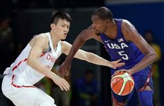 United States' Kevin Durant drives past China's Zou Peng, left, during a basketball game at the 2016 Summer Olympics in Rio de Janeiro, Brazil,…