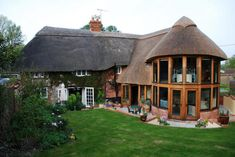 The Timber Frame Company portfolio. Our portfolio of finished oak framed extensions and Douglas fir extensions. Here you will find a range of modern and traditional designs - everything from an access cover to a large oak framed extension with sea views. Oak Framed Extensions, House Extensions, Thatched House, Thatched Roof, Building Extension, Glass Extension, Extension Ideas, Cottage Extension, Cottage Renovation