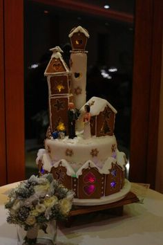 Gingerbread wedding cake complete with fairy lights - perfect for a Christmas wedding