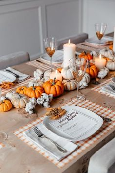 Fall Dining Room Decoration Idea With Plaid Placemats And A Bold Fall Centerpiece Of Neutral And Orange Pumpkins Plus Candles Fall Table Settings, Thanksgiving Table Settings, Thanksgiving Centerpieces, Autumn Party Decorations, Fall Table Centerpieces, Wedding Decoration, Fall Party Themes, Pumpkin Decorations, Easter Centerpiece