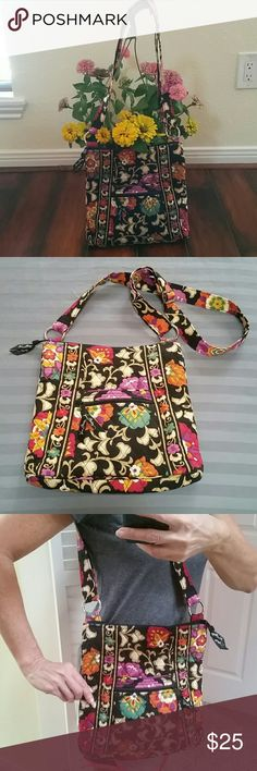Spring Bloom Hobo Style bag Beautiful spring colored bag. Adjustable  straps to wear as shoulder or crossbody. Two front pockets. One back pocket with zip. One large main compartment  with zip closure. Three small slip pockets also on the interior. All buckles are Vera Bradley engraved. Used only on a four day weekend to the Caribbean. Excellent condition! Vera Bradley Bags Crossbody Bags