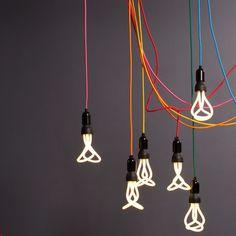 The Original Plumen 001 is the world's first designer low energy light bulb. Ampoule Design, Low Energy Light Bulbs, Deco Luminaire, Kartell, Pendant Set, Save Energy, House Colors, Pendant Lighting, Wall Lighting