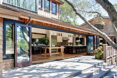 indoor-outdoor kitchen. wow I LOVE
