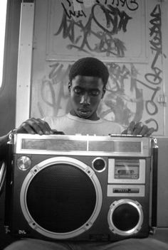 80s rap, hip-hop, boombox, NYC, subway car, graffiti. 1984.
