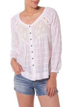 Everyone needs a peasant blouse for Spring and Summer, and you will love this one from Silver Jeans Co. Relaxed and flowy, this peasant blouse combines a subtle plaid with floral embroidery for a look that's ready for warm weather. Lattice cutouts add a bit more romance, and sheer panels bring this boho chic look together. Add skinny denim and sky-high wedges for the perfect balance. Embroidered Peasant Blouse by Silver Jeans Co.. Clothing North Shore, Boston, Massachusetts